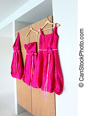 Bridesmaid dresses - Bright pink bridesmaids dresses hanging...