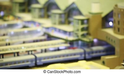 toy trains stand on platforms in big passenger station with...