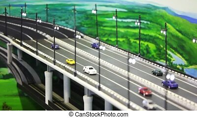 toy tiny automobile cars stand on bridge before drawn...
