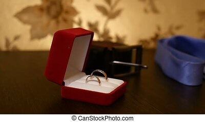 wedding rings in the video red box on the table - wedding...