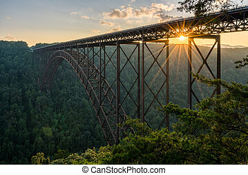Sunset at the New River Gorge Bridge in West Virginia -...