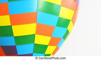 part of coloured toy air ball revolves on white background