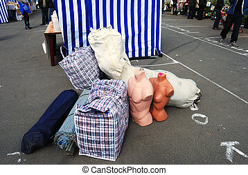 market place - bags, mannequins and tent on the market place