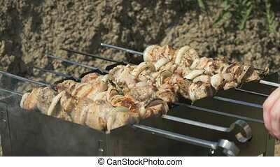 Kebabs are roasted on the metal skewers on coals - Kebabs...