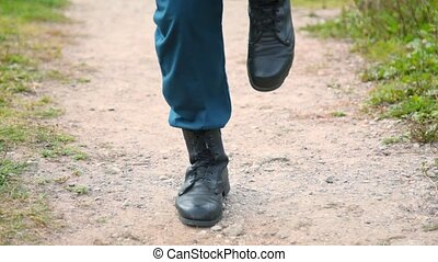 soldier in military boots running on the spot