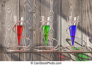 Glass vessels on wooden background - Three glass vessels...