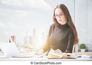 Attractive woman working on project - Portrait of attractive...