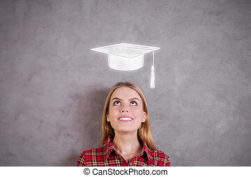 Graduation concept - Portrait of attractive young woman...