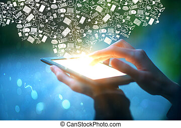 Hands holding tablet with communication icons - Closeup of...