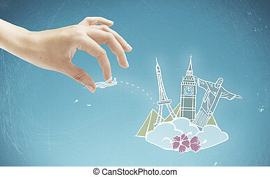 Traveling concept - Female hand holding abstract airplane...