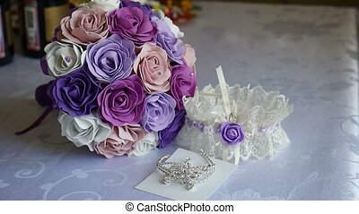 bridal bouquet of blue, purple and white roses on a table...