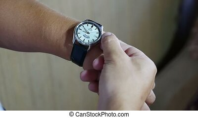 video a man with a clock on the hand - video a man with...