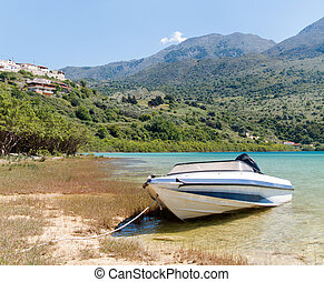 Lonely motor boat on the lakeside