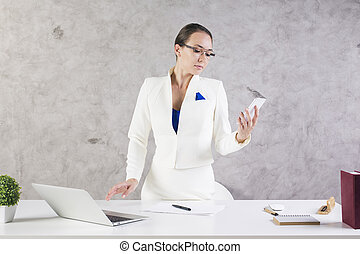 Woman using cellular phone - Attractive young businesswoman...