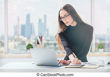 Businesslady working on project - Portrait of concentrated...