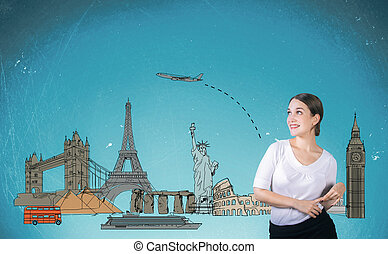 Traveling concept with charming young lady with sketch on...