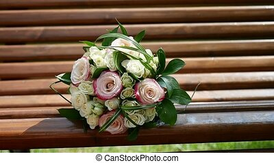 on the bench is white - pink bridal bouquet video - on bench...