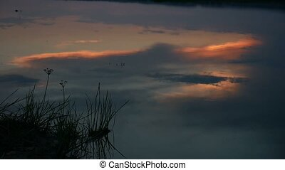 night river sunset lake reflection of clouds in water...