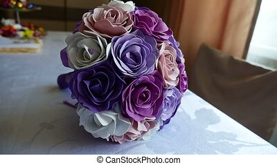 video bridal bouquet of blue, purple and white roses on a...
