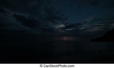 Time lapse thunderstorm clouds at night - Time lapse of...
