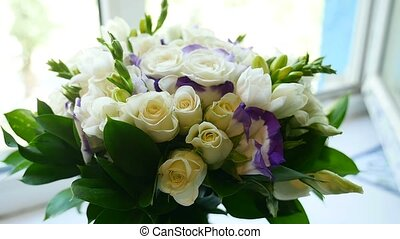 small bouquet of white roses on the window video - small...
