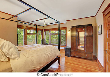 Interior of master bedroom with canopy bed and beautiful...