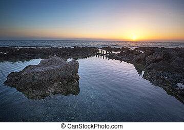 idyllic sunset at the coastline of Alcala, tenerife, Canary...