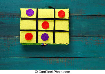 Noughts and crosses game - Flat lay of handmade Noughts and...