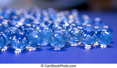 Mystic Marbles - Marbles with reflection of blue mat