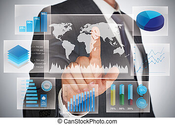 Touch screens - Businessman looking at world map and charts...