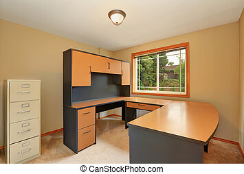 Interior of home office with  new black and brown furniture set.