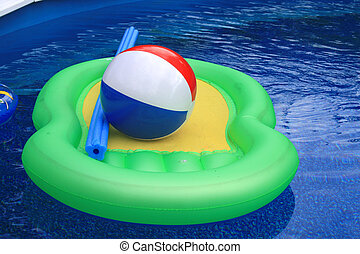 Water and pool with inflatable toys, floaty,beach ball