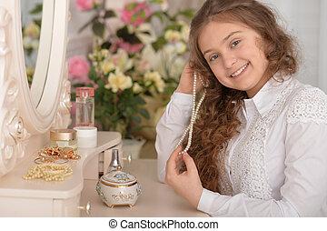 cute girl near the mirror at home