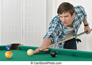 man playing billiards in  billiard club