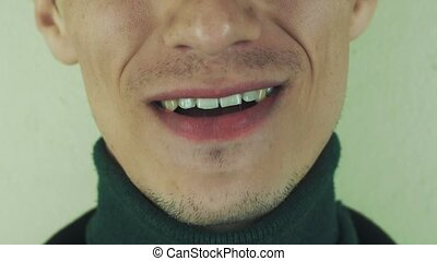 Adult man pronounce words in front camera. Mouth. Teeth. Bristle. Show tongue