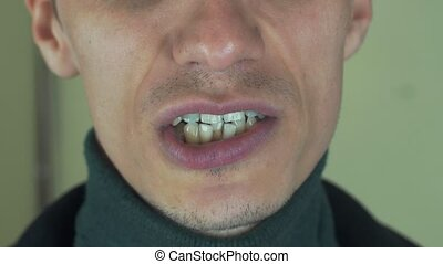 Adult man pronounce words in front camera. Mouth. Sing song. Bristle. Teeth