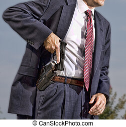 The draw - Person with a concealed carry permit starting to...