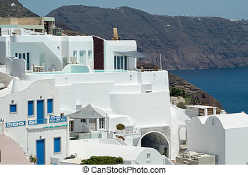 Traditional architecture of Oia village on Santorini island,...