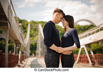 romantic couple having a date on  bridge