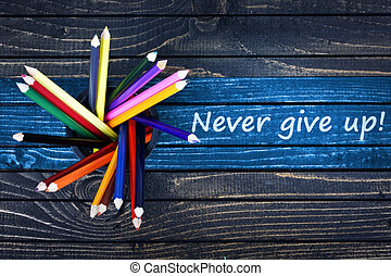 Never give up text painted and group of pencils - Never give...