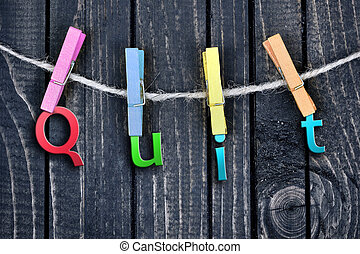word hanging on clips and wooden wall