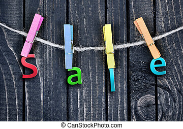 Sale word hanging on clips