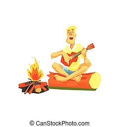 Guy Playing Guitar Sitting On A Log Next To Bonfire