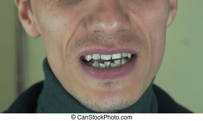 Adult man with bristle singing song in front camera. Mouth....