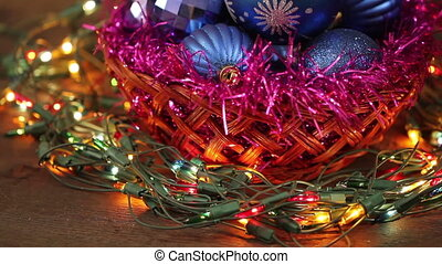 Christmas balls and garland flashing tangled on the floor