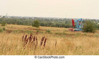 Oil well in the field. Landscape HD