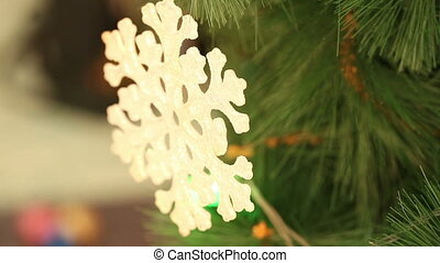 Christmas ornaments snowflake hanging on a branch....