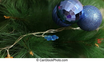 A bunch of blue balls on the Christmas tree