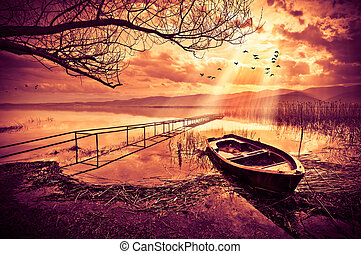 Boat on the lake at sunset
