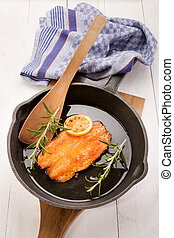 grilled scottish kipper in a cast iron pan - grilled...